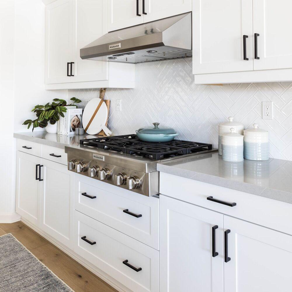 gray kitchen rug in white kitchen