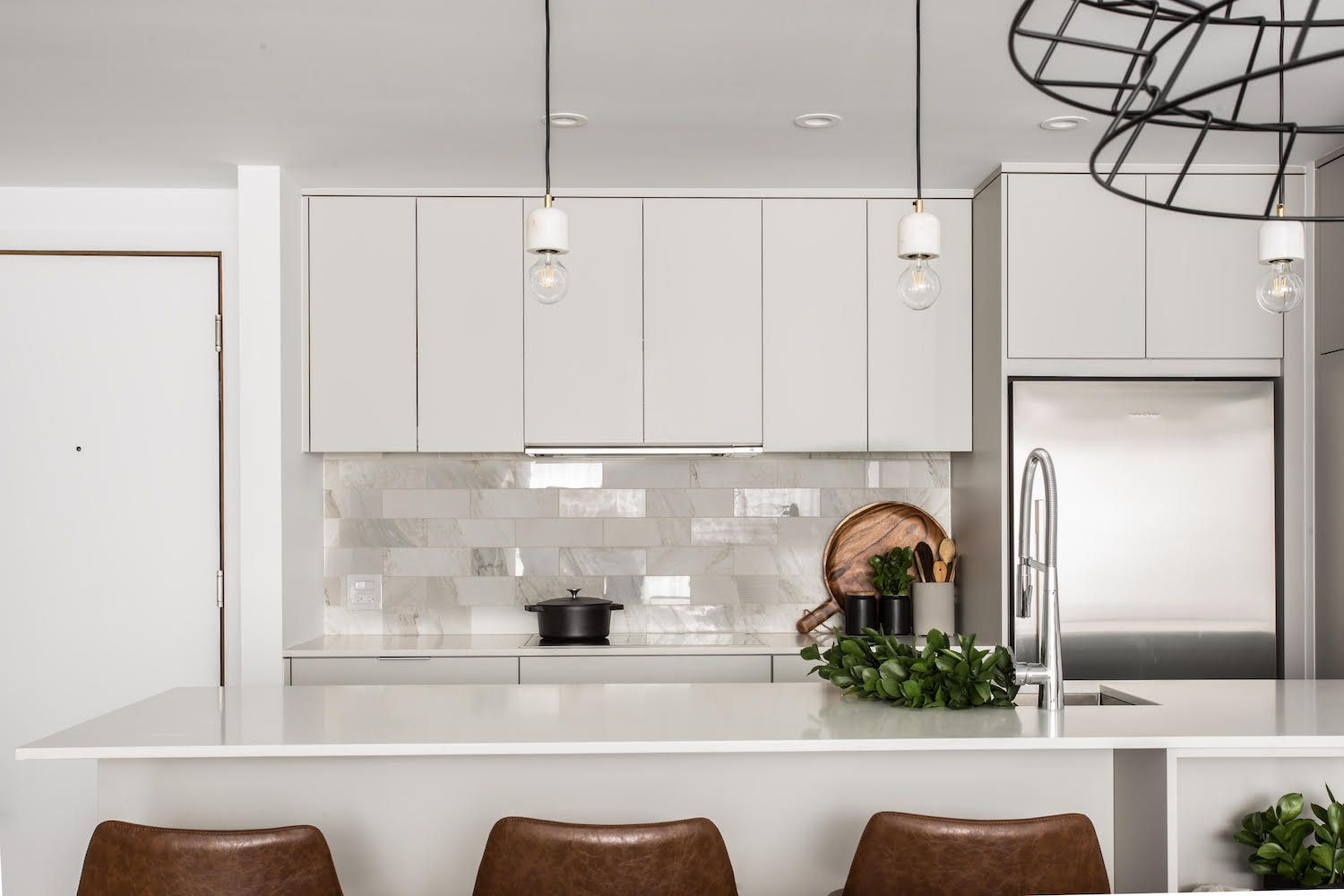 Kitchen with light gray cabinets