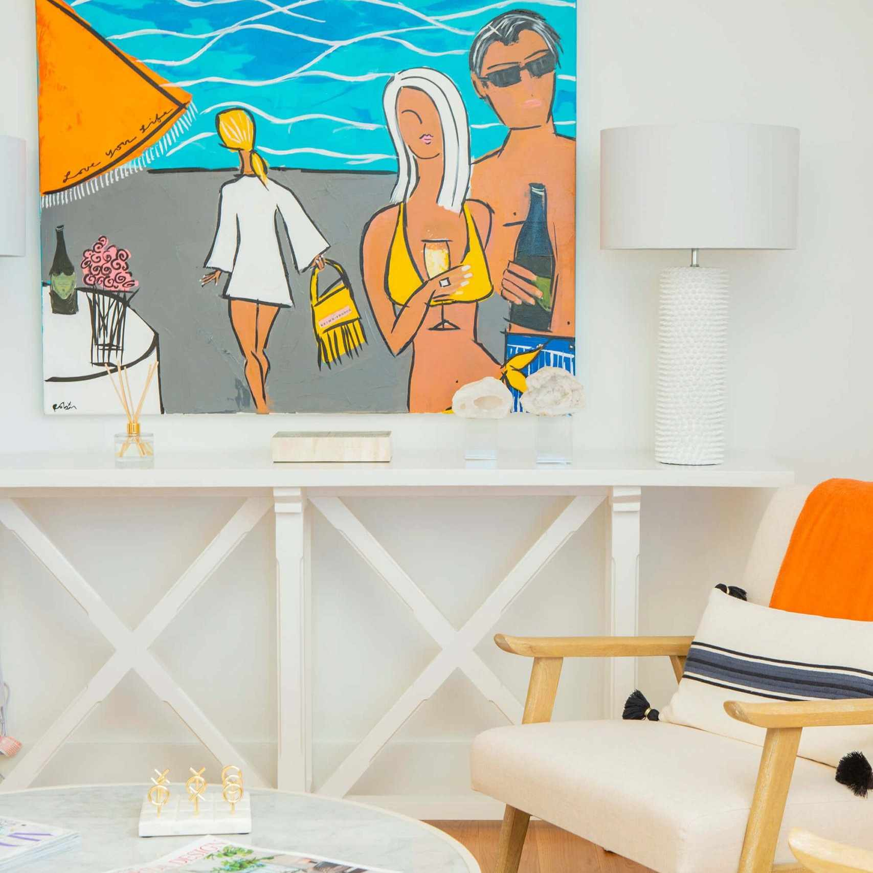 Foyer in orange, blue, white tones, round coffee table