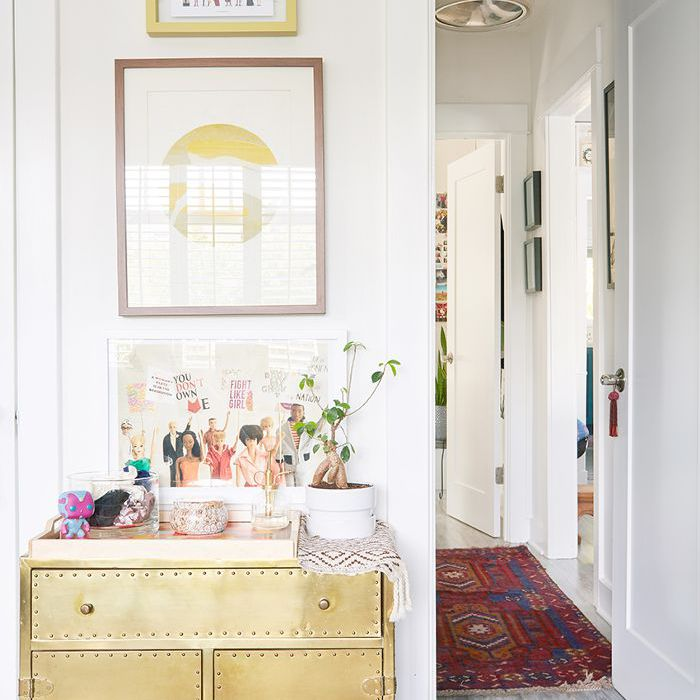 Modern nursery with gold accents