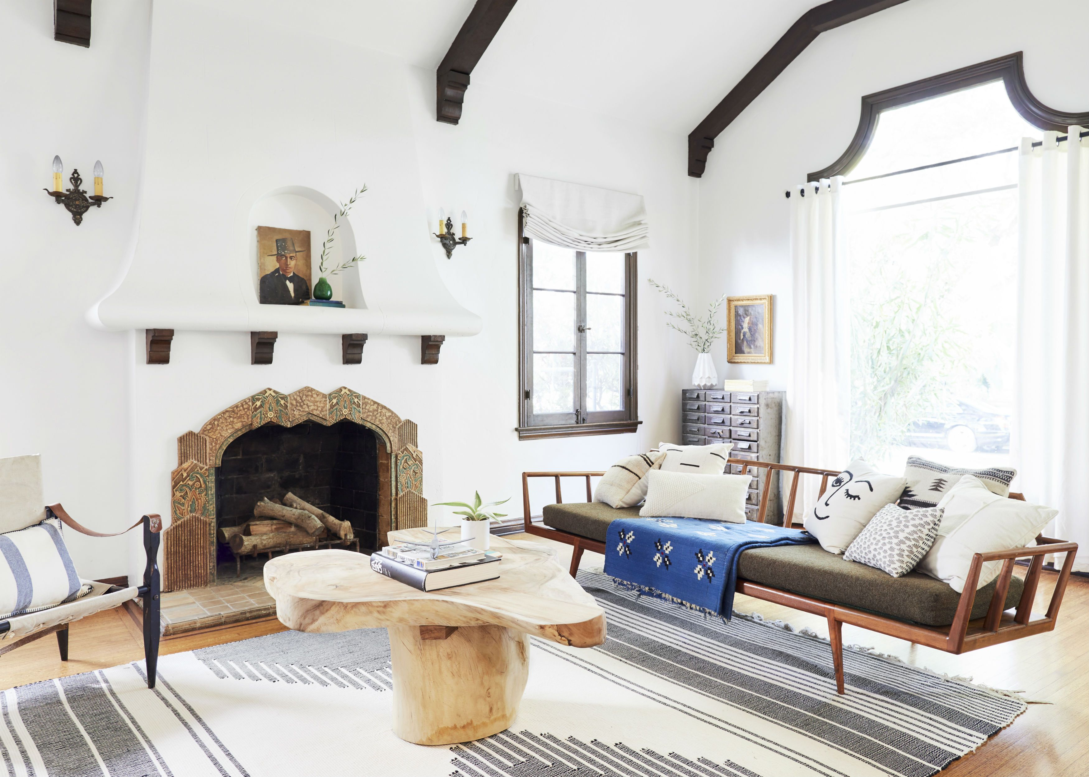 Southwestern style living room with rustic fireplace