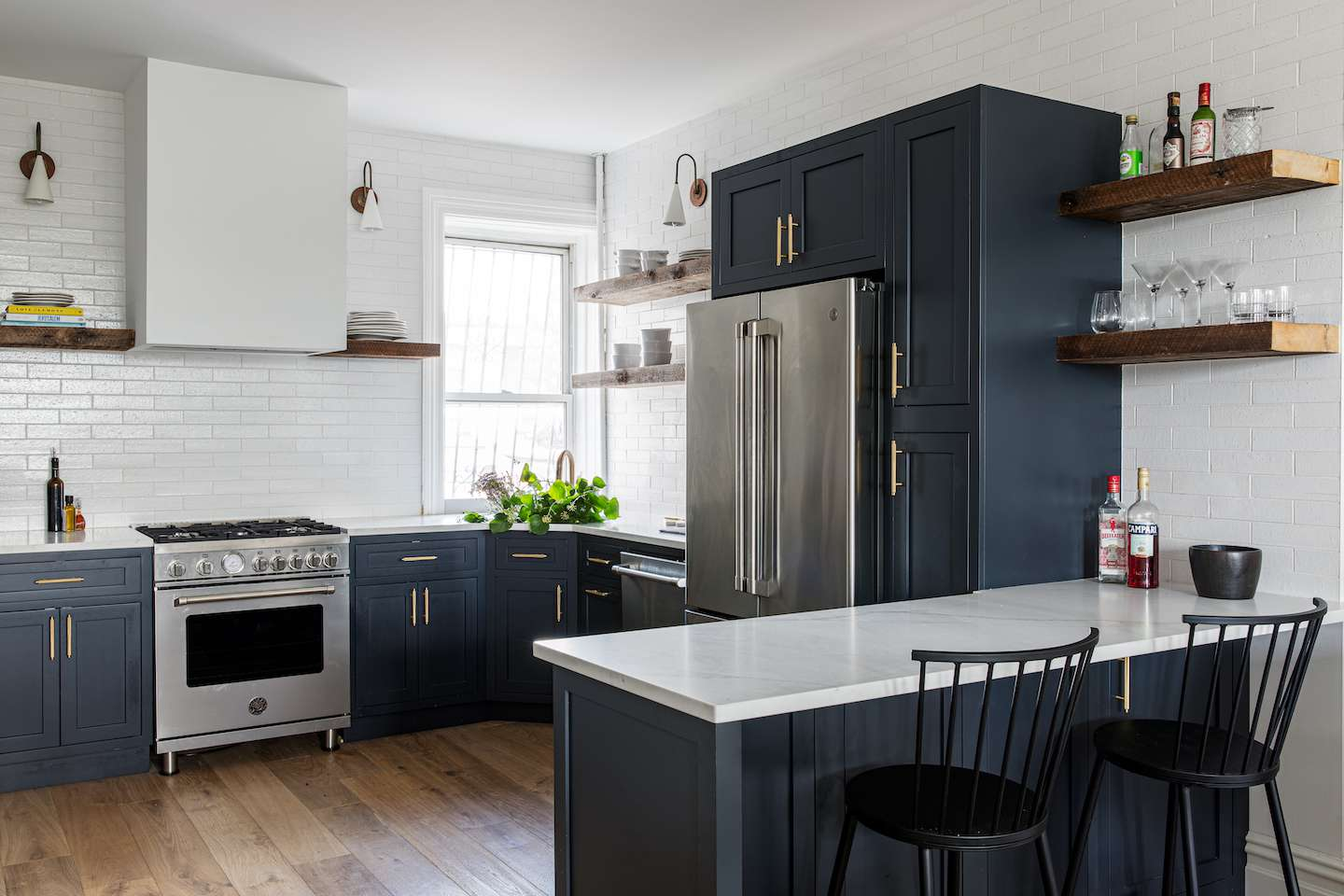 Shot of the navy blue kitchen with eat-in counter.