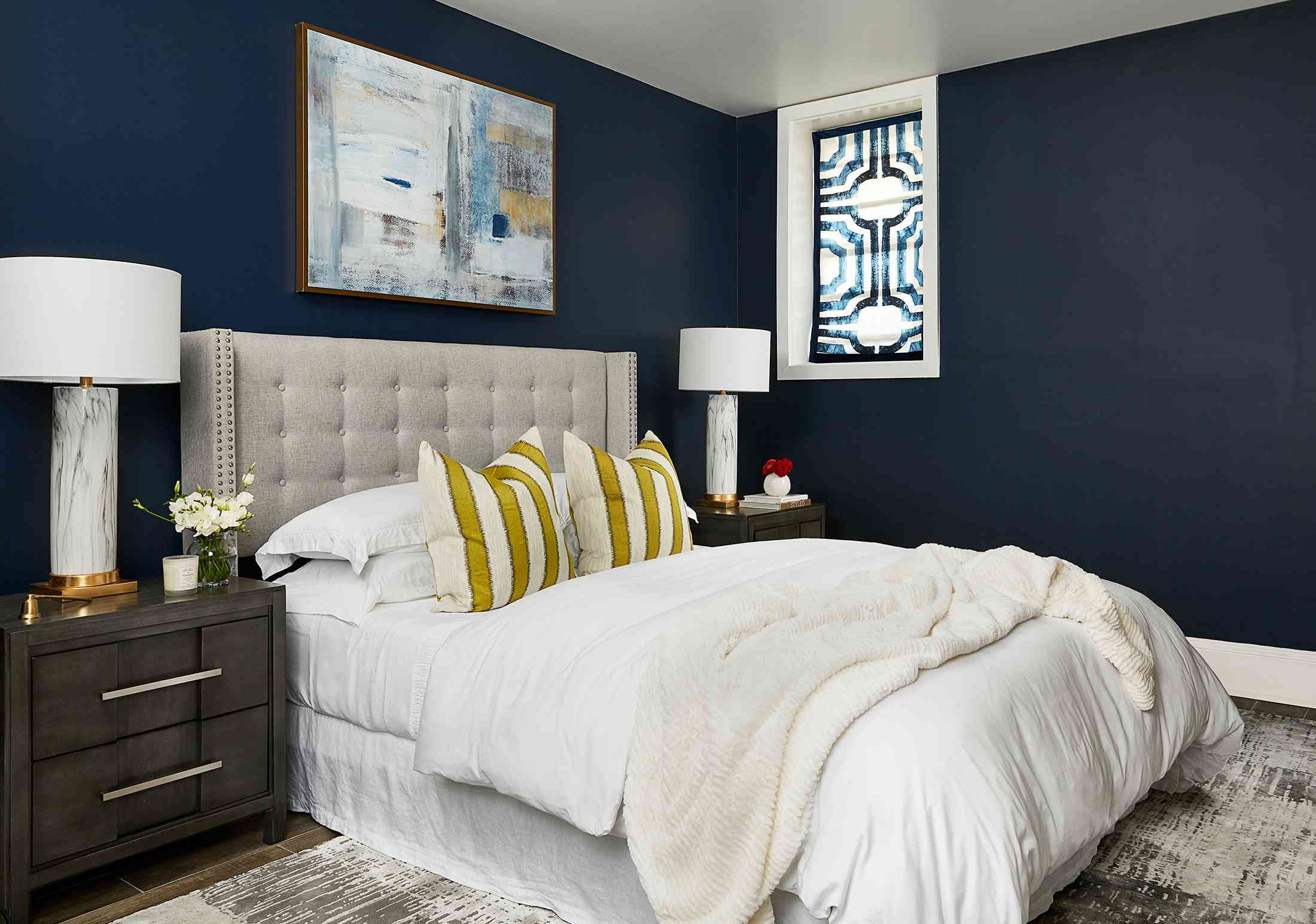 Duke Ellington home tour - bedroom with navy blue walls and comfy white bedding