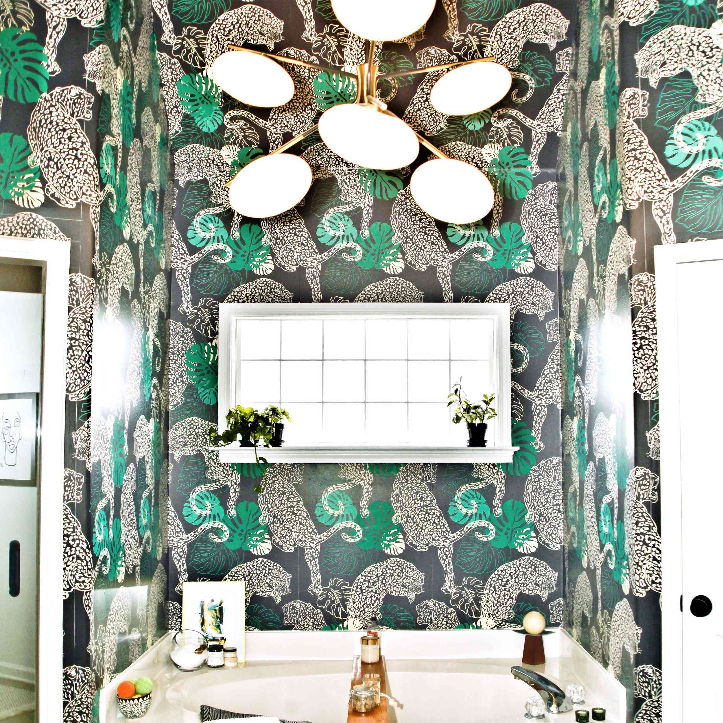 Dramatic bathroom with jaguar wallpaper and modern fixtures