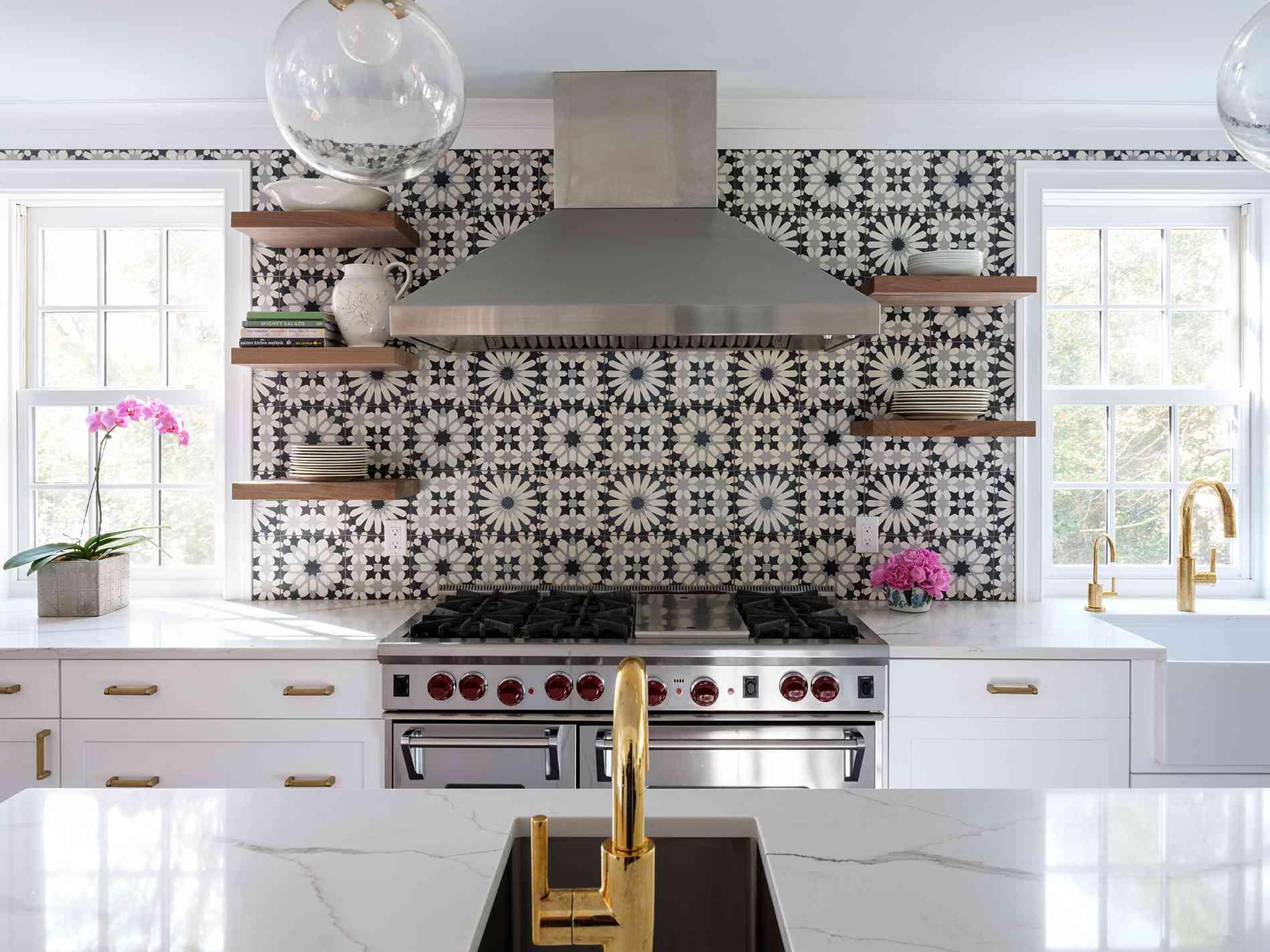 Kitchen with black and white backsplash.