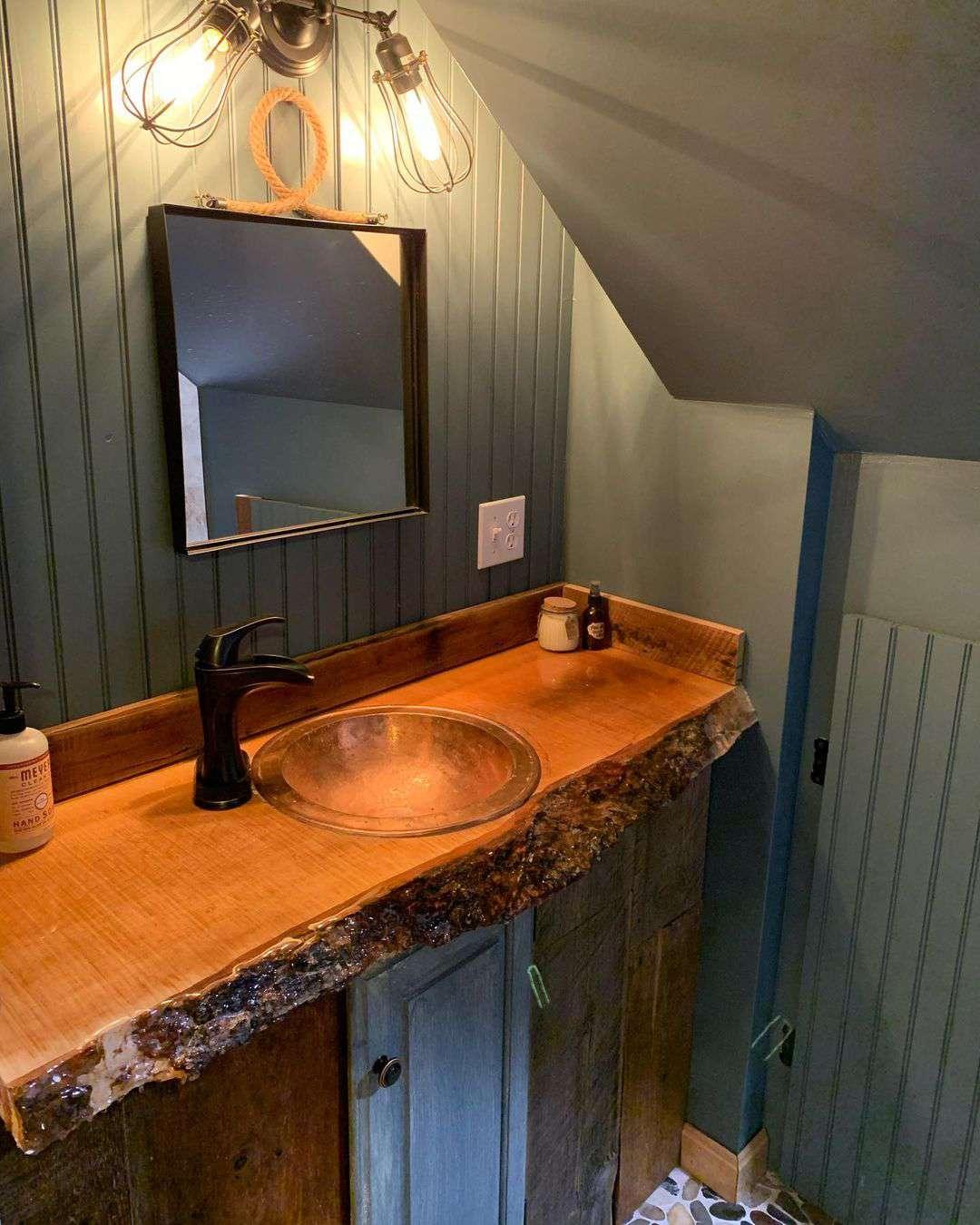 Bathroom with green walls and wood vanity
