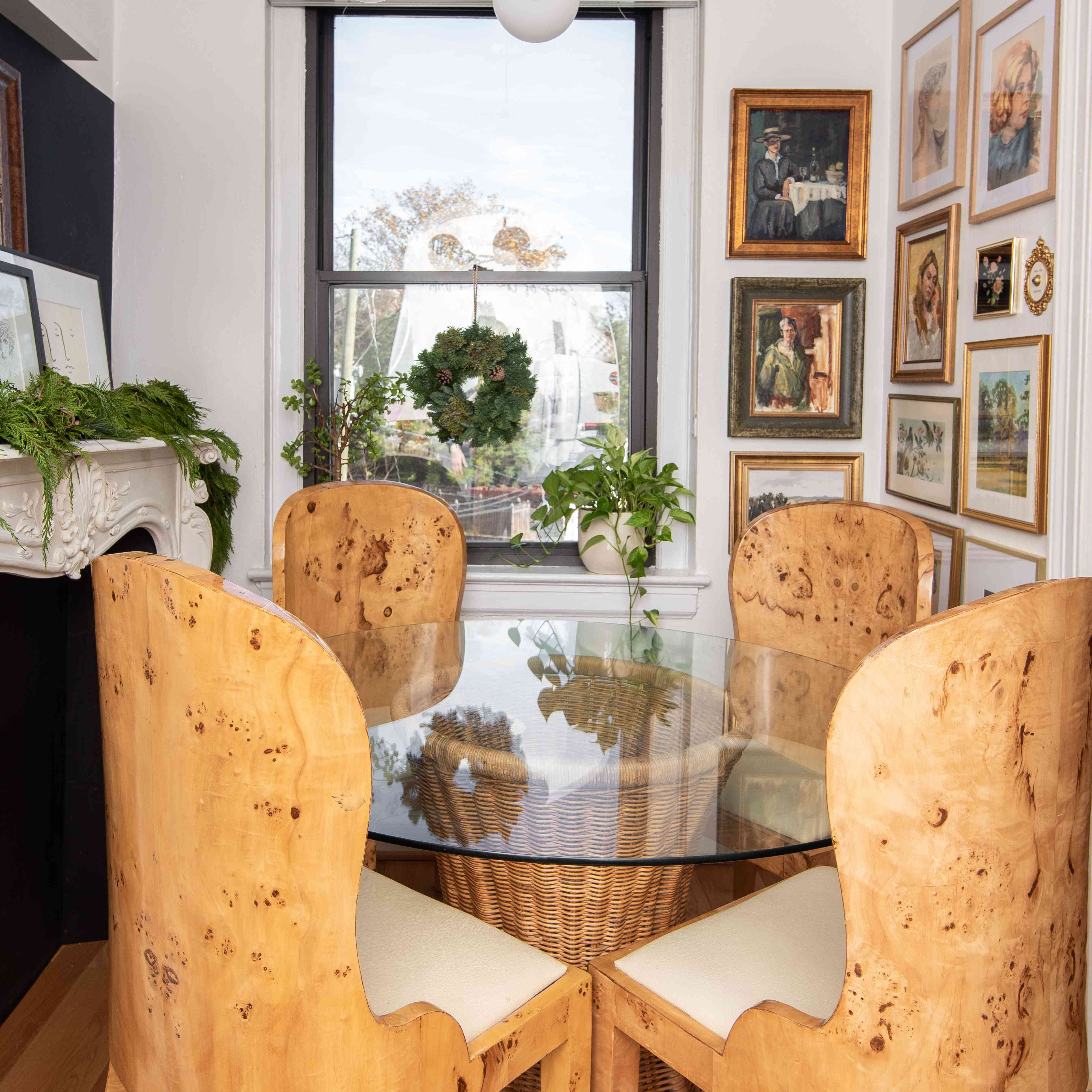 Burl wood dining chairs at table.
