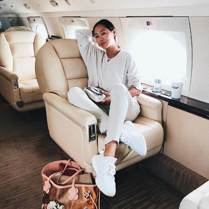 a woman sitting in a plane