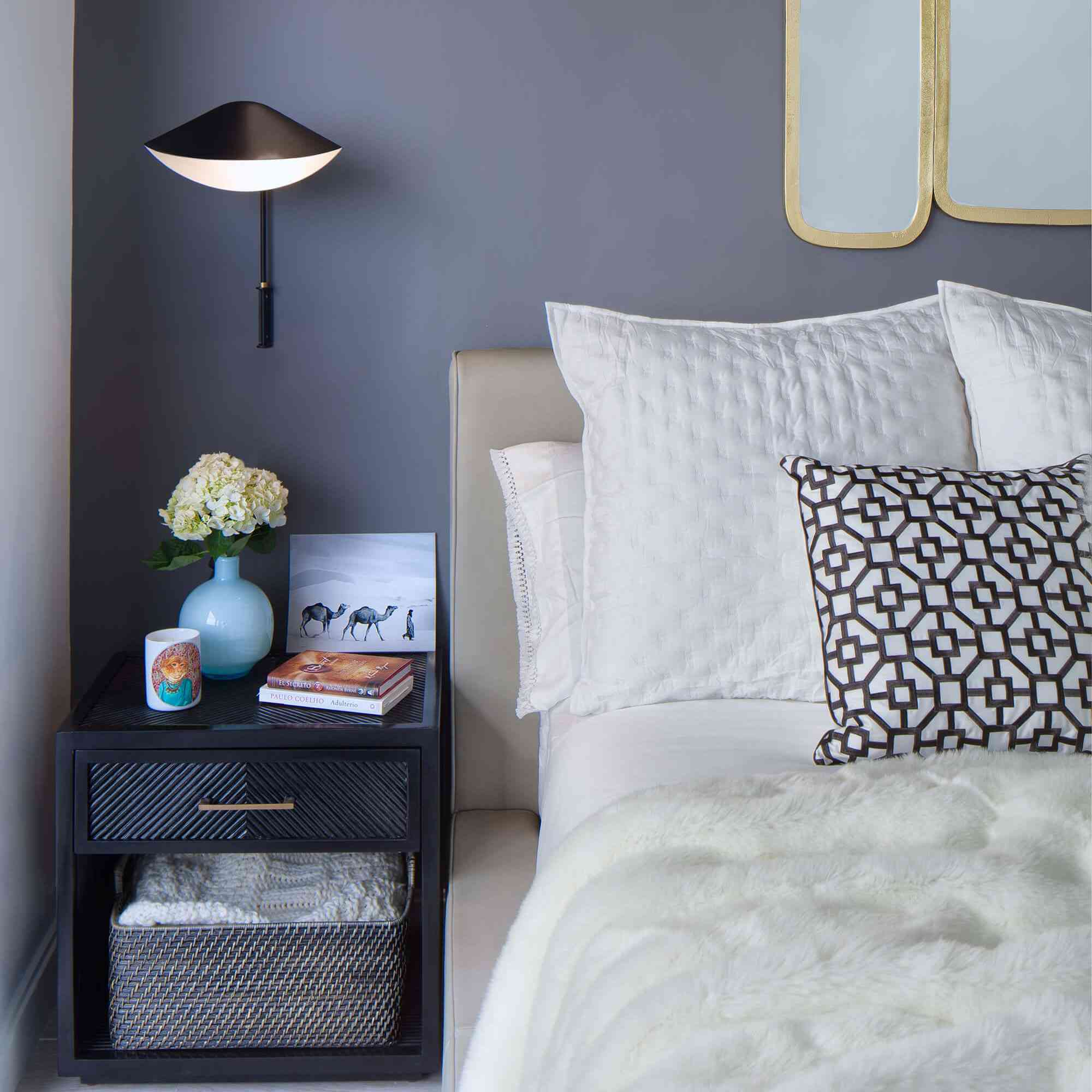 Dark blue-gray bedroom with white and black accents