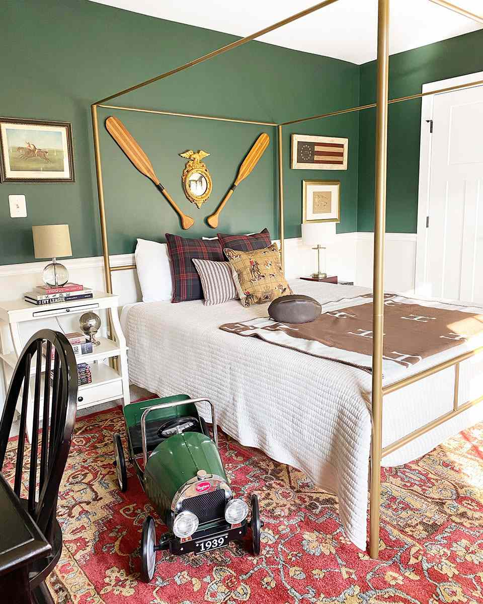 Green woodsy bedroom with boy.