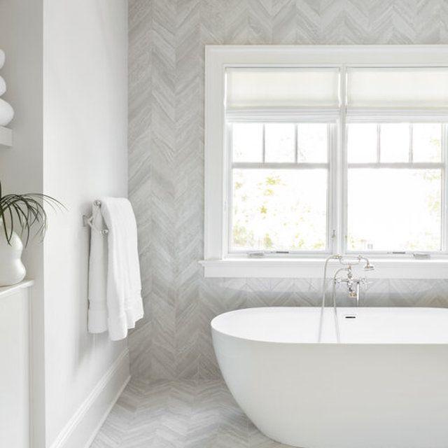 White bathroom with herringbone walls and floor