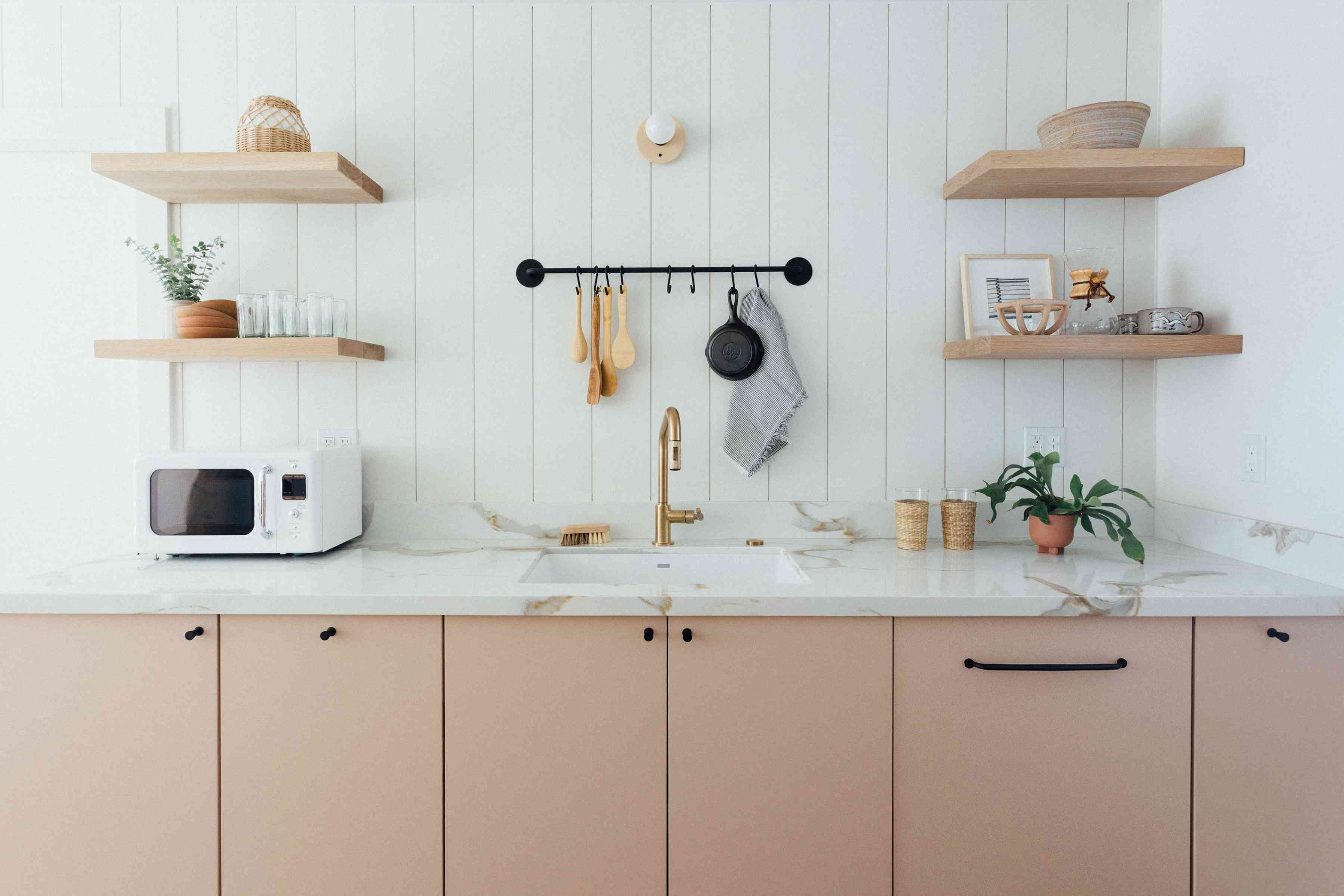 Pink kitchen with floating shelves