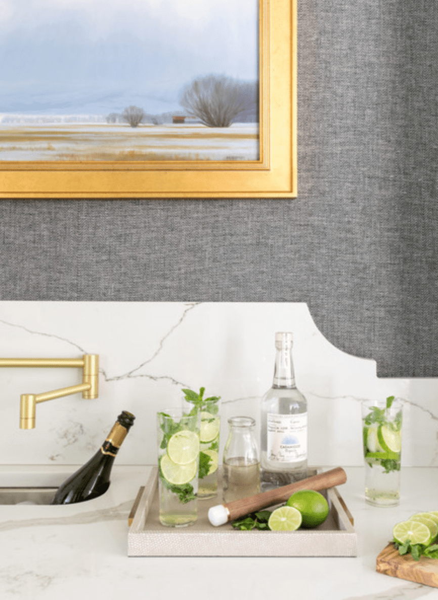A kitchen wall, lined with gray fabric