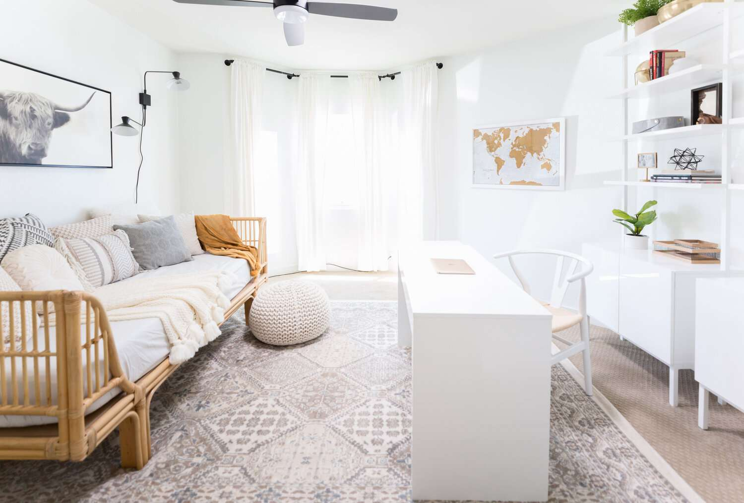 Small space living room with white desk and bamboo sofa