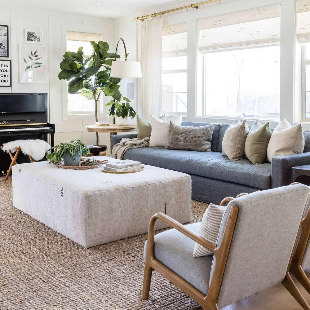 best living room ideas - blue couch and neutral accents
