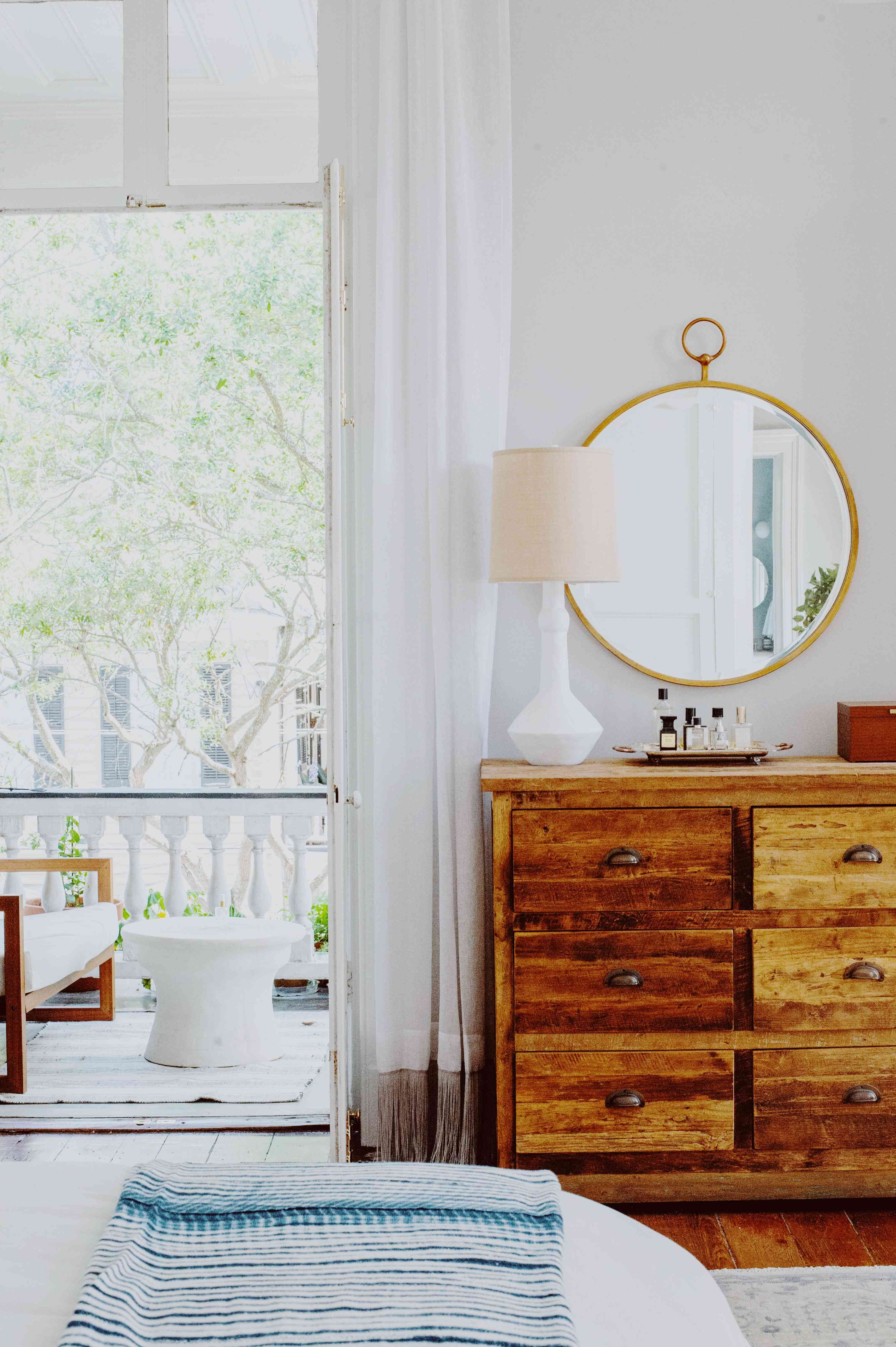 Amanda Greeley home tour - bedroom with patina dresser and balcony