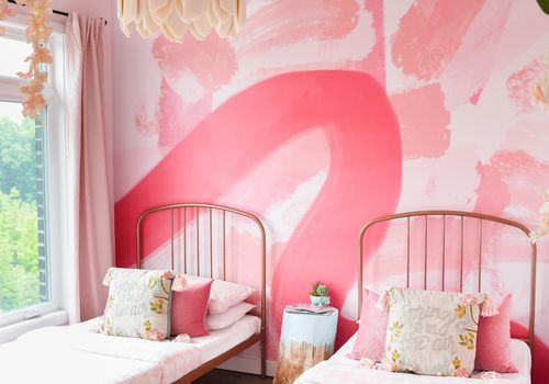 Whimsical girls pink bedroom.