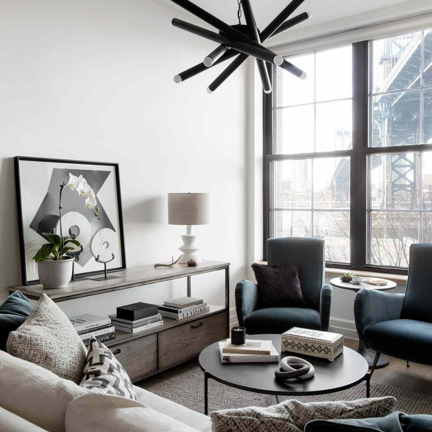Apartment living room with black and white geometric chandelier.