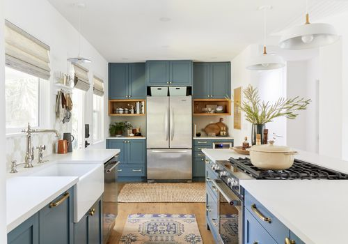 Cool California style kitchen with teal cabinets.