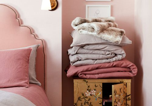 pink bedroom with pink headboard