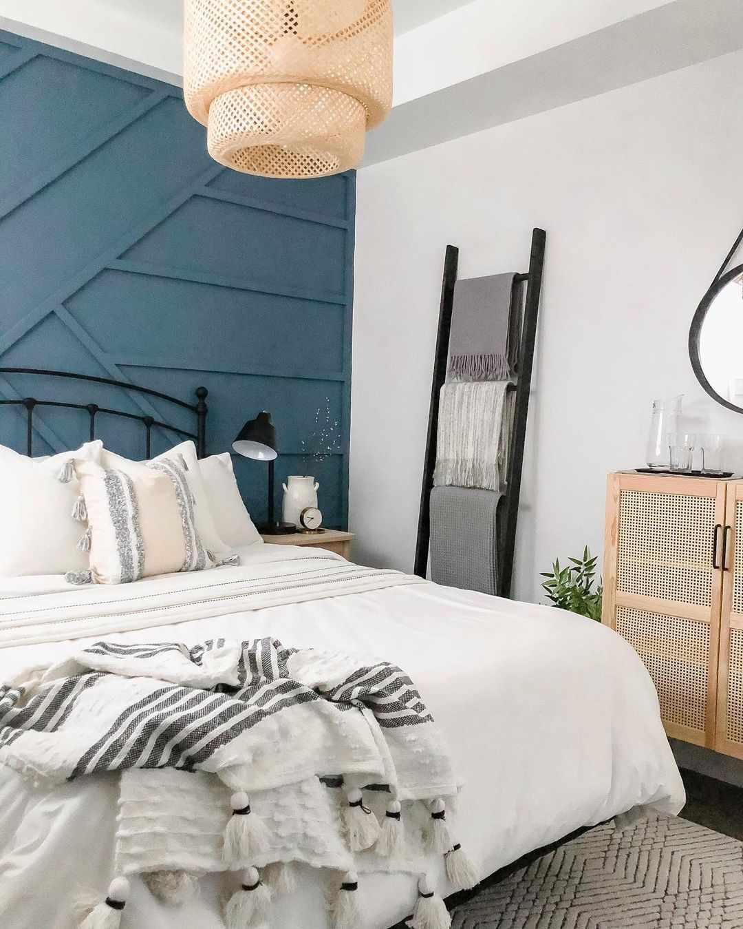 Bedroom with hanging blanket ladder