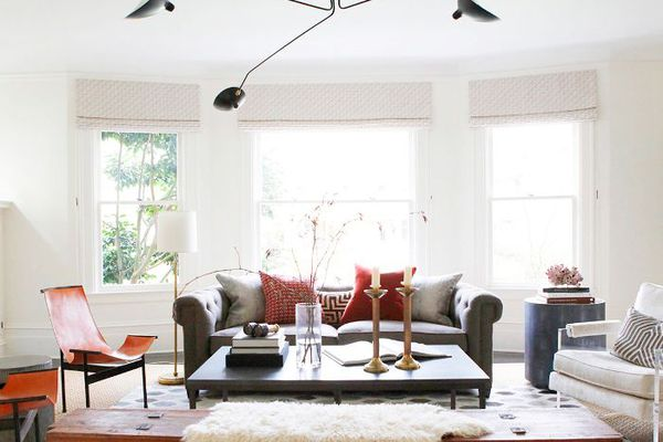 a living room with a rounded sofa