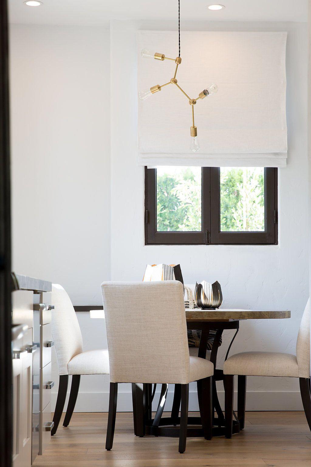 Transitional dining nook with sputnik chandelier