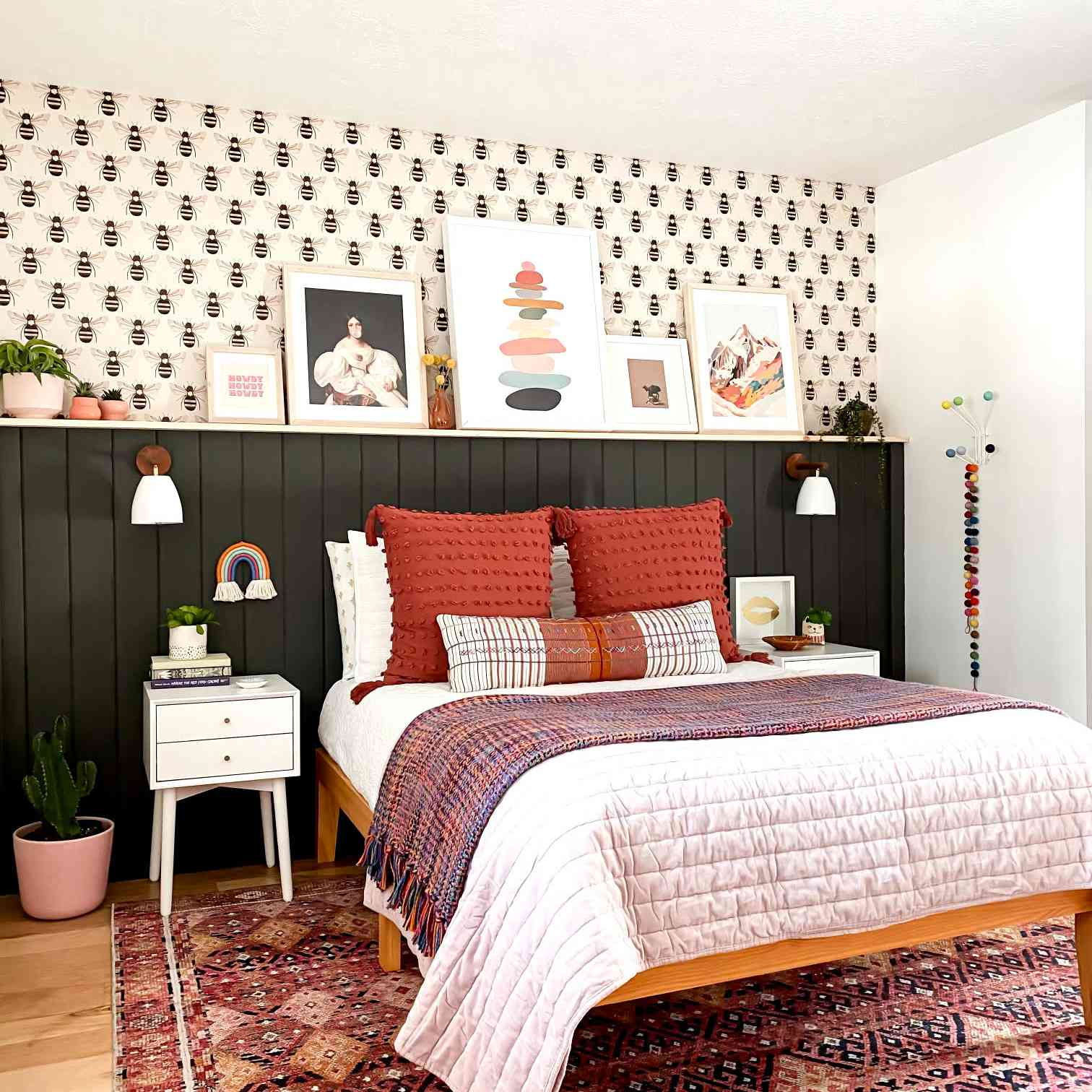 Colorful bedroom with hunter green shiplap wainscoting