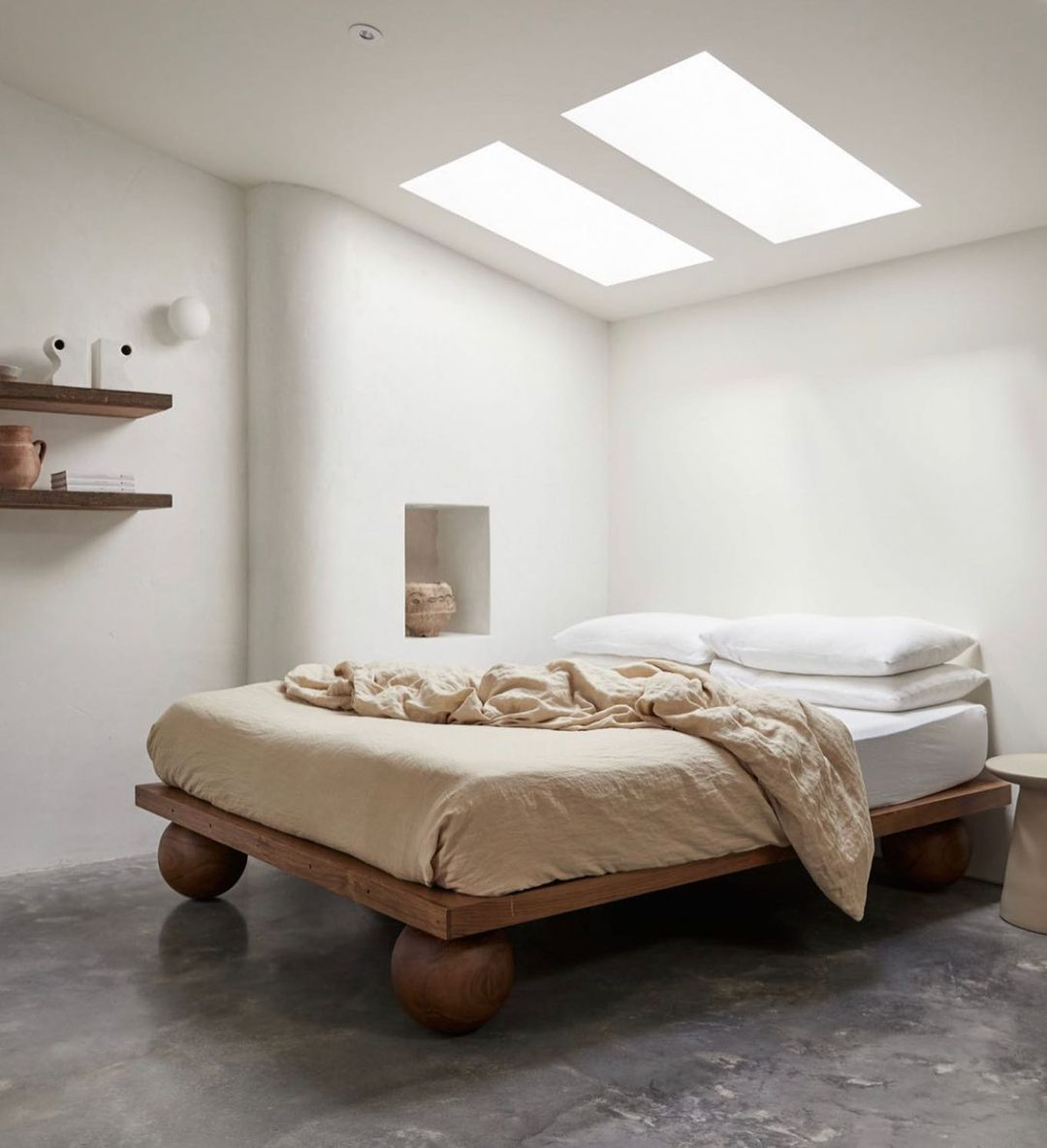 Bed with neutral linens.