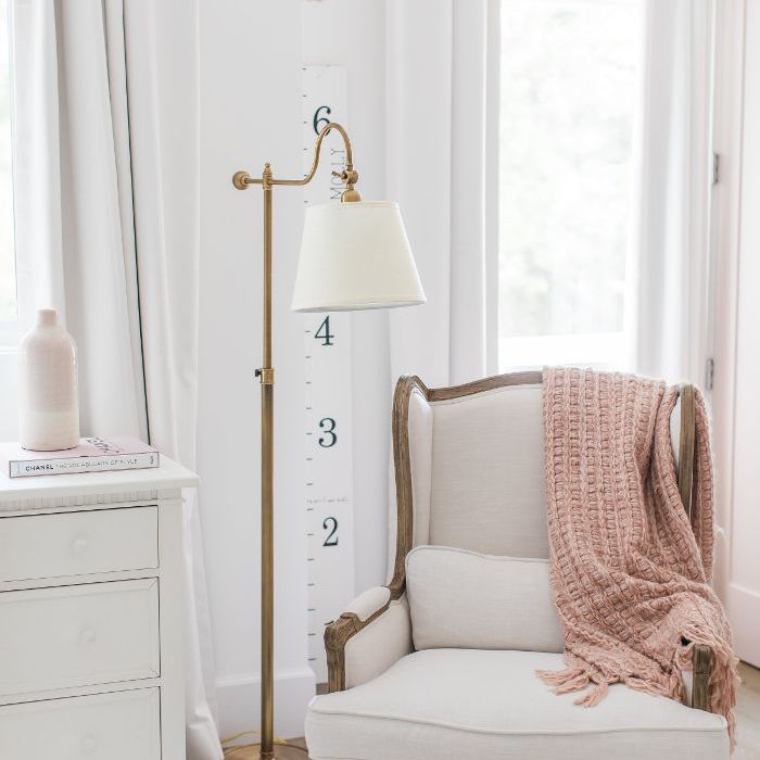 More white and blush colored seating in Ali Fedotowsky home