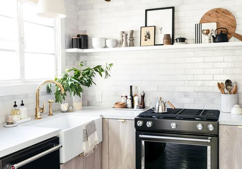 A kitchen with custom IKEA cabinets