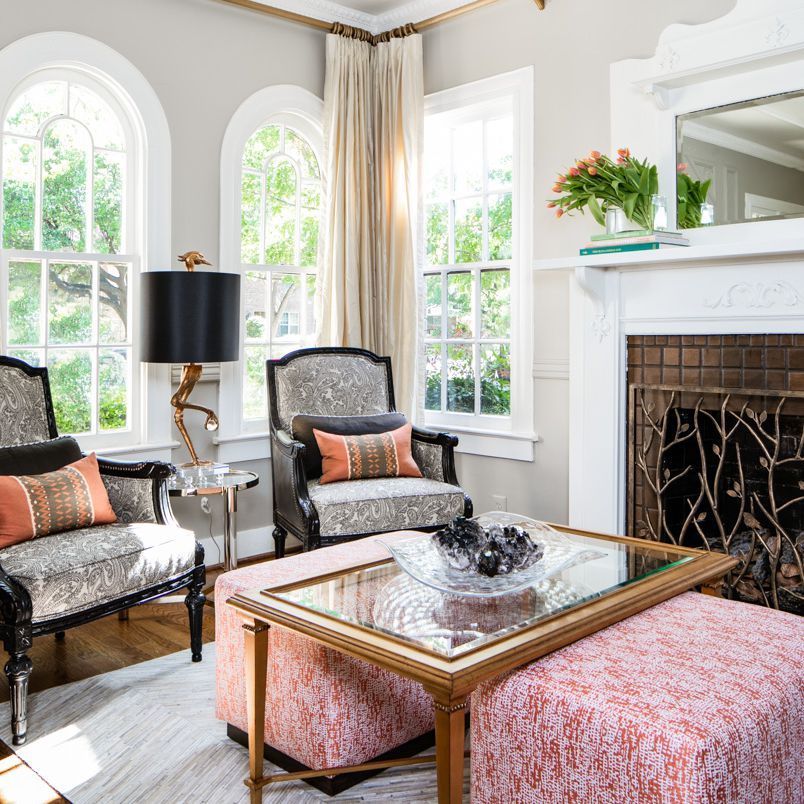 traditional living room with versatile ottomans