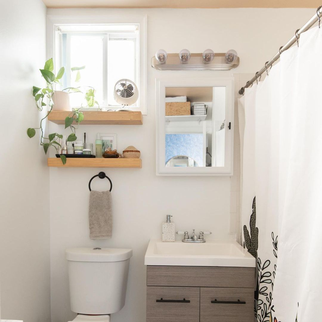 Bathroom with white medicine cabinet and shelves.