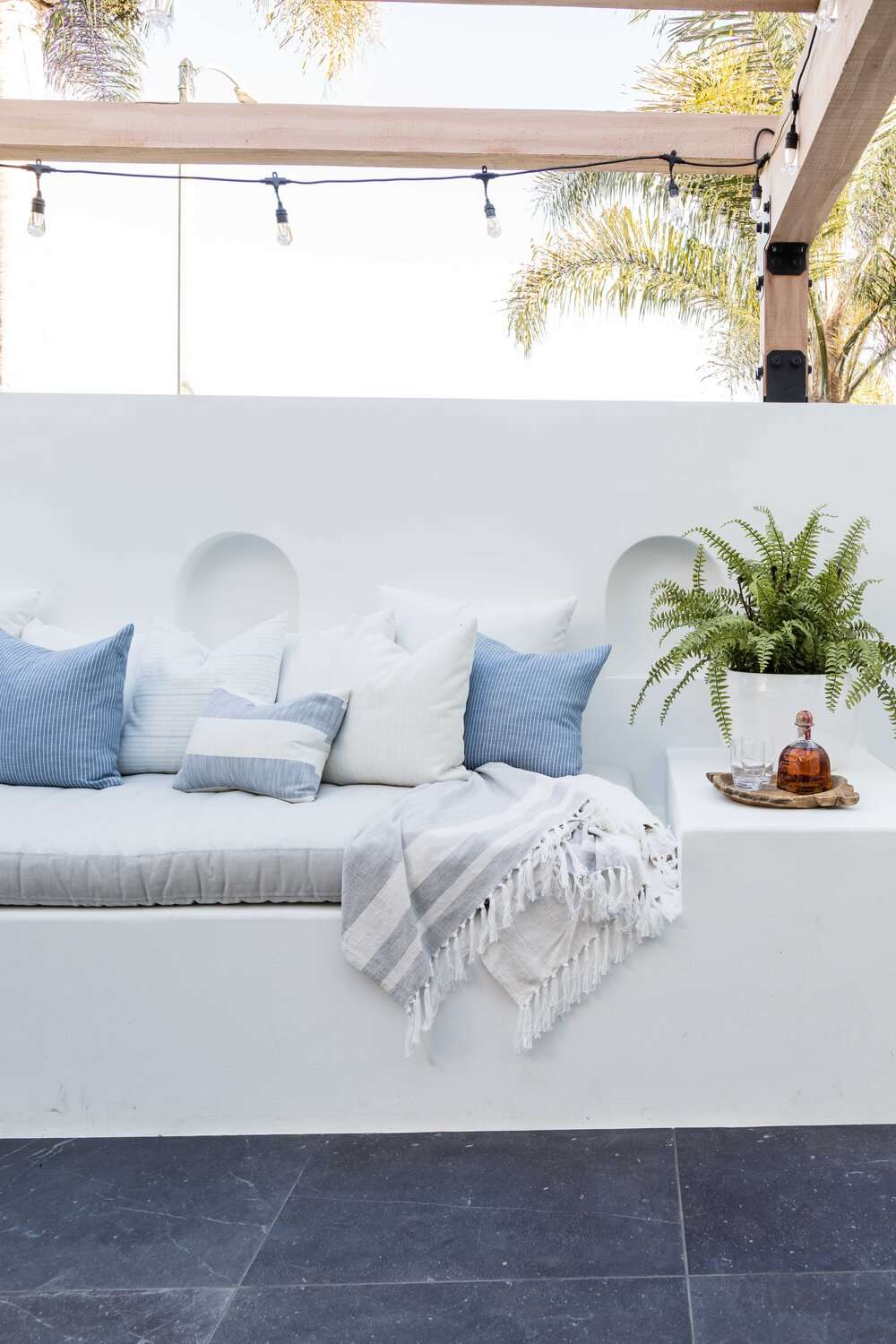 White built-in bench on a porch