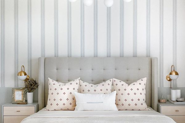 Fresh spring bedding with neutral pillows.