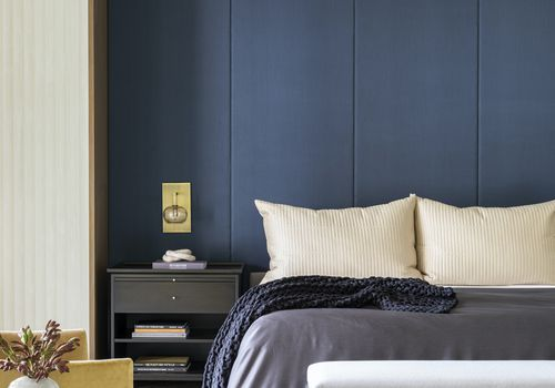 Navy blue accent wall.
