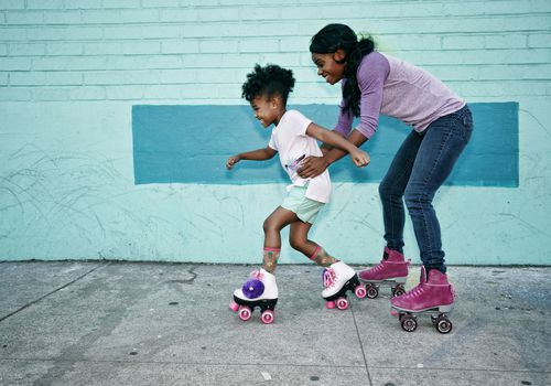 mother and daughter roller-skating