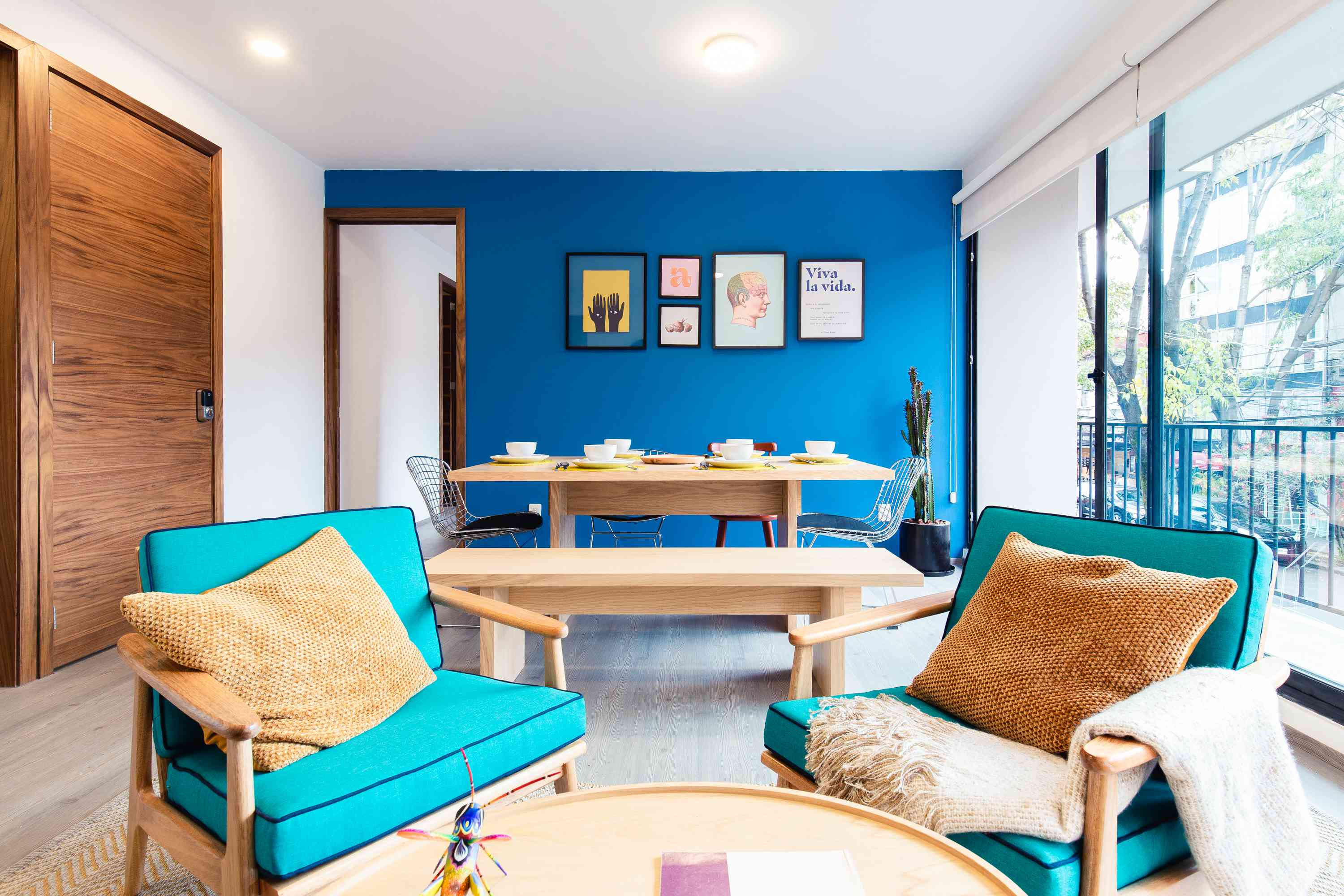Bright blue living and dining combo