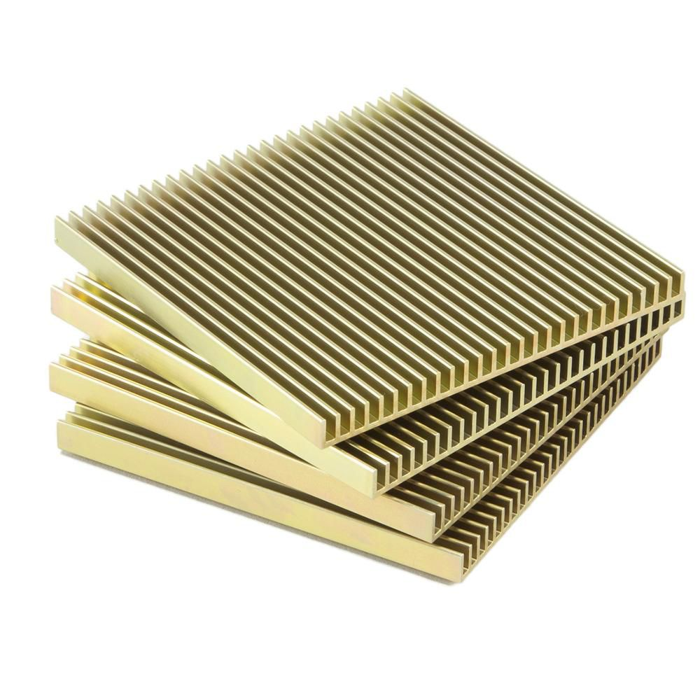 A set of four gold-tone ridged square coasters.