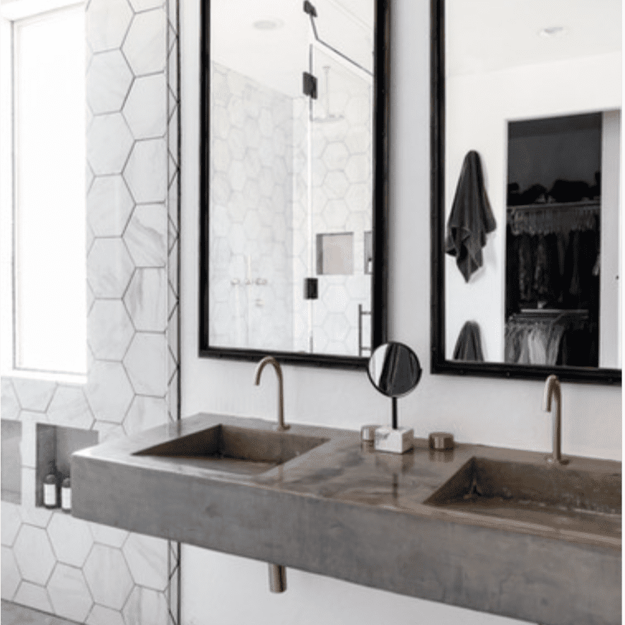 Bathroom with marble, hexagonal-shaped shower tile, concrete sinks