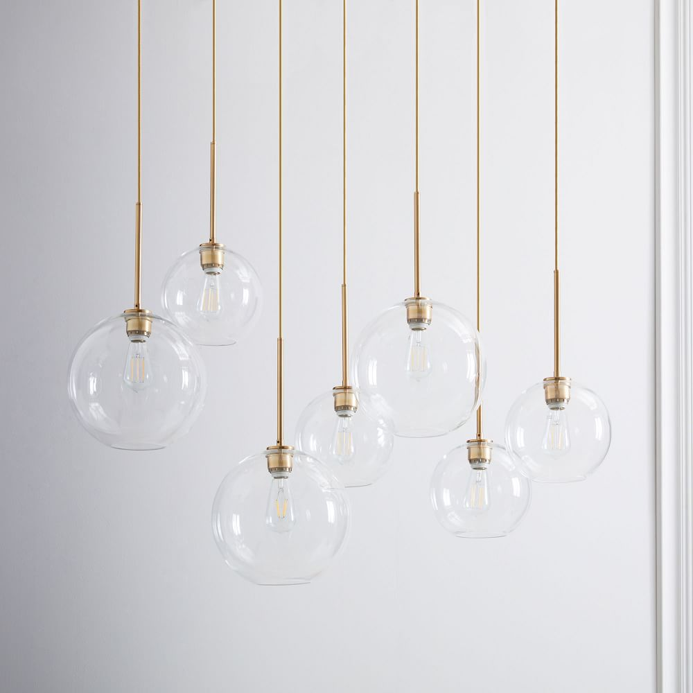 A series of globe pendant lights, currently for sale at West Elm