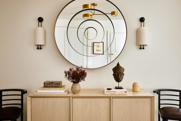 Wooden dresser and unique spiral mirror.