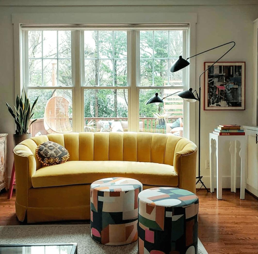 Yellow tufted velvet sofa.
