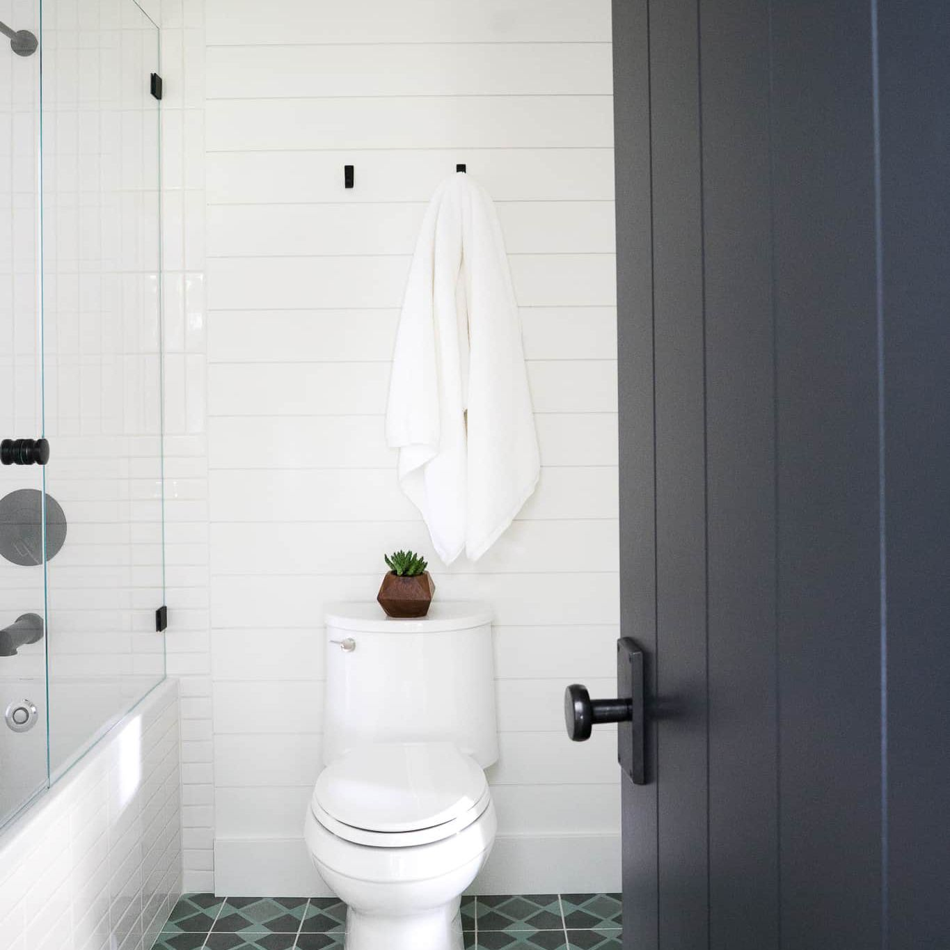 A white bathroom with bold blue tiles