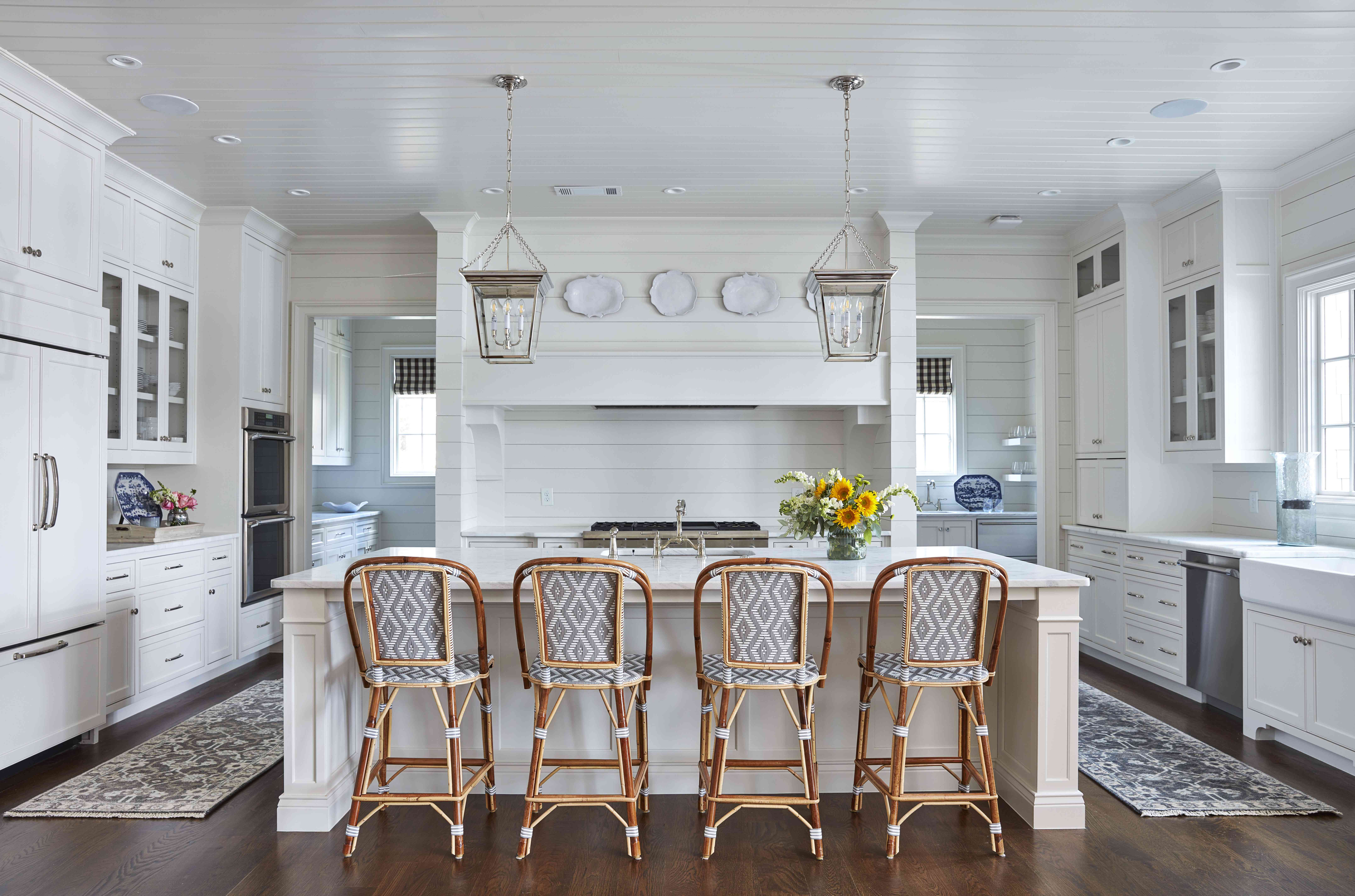 best kitchen ideas - traditional kitchen with rattan stools and shiplap