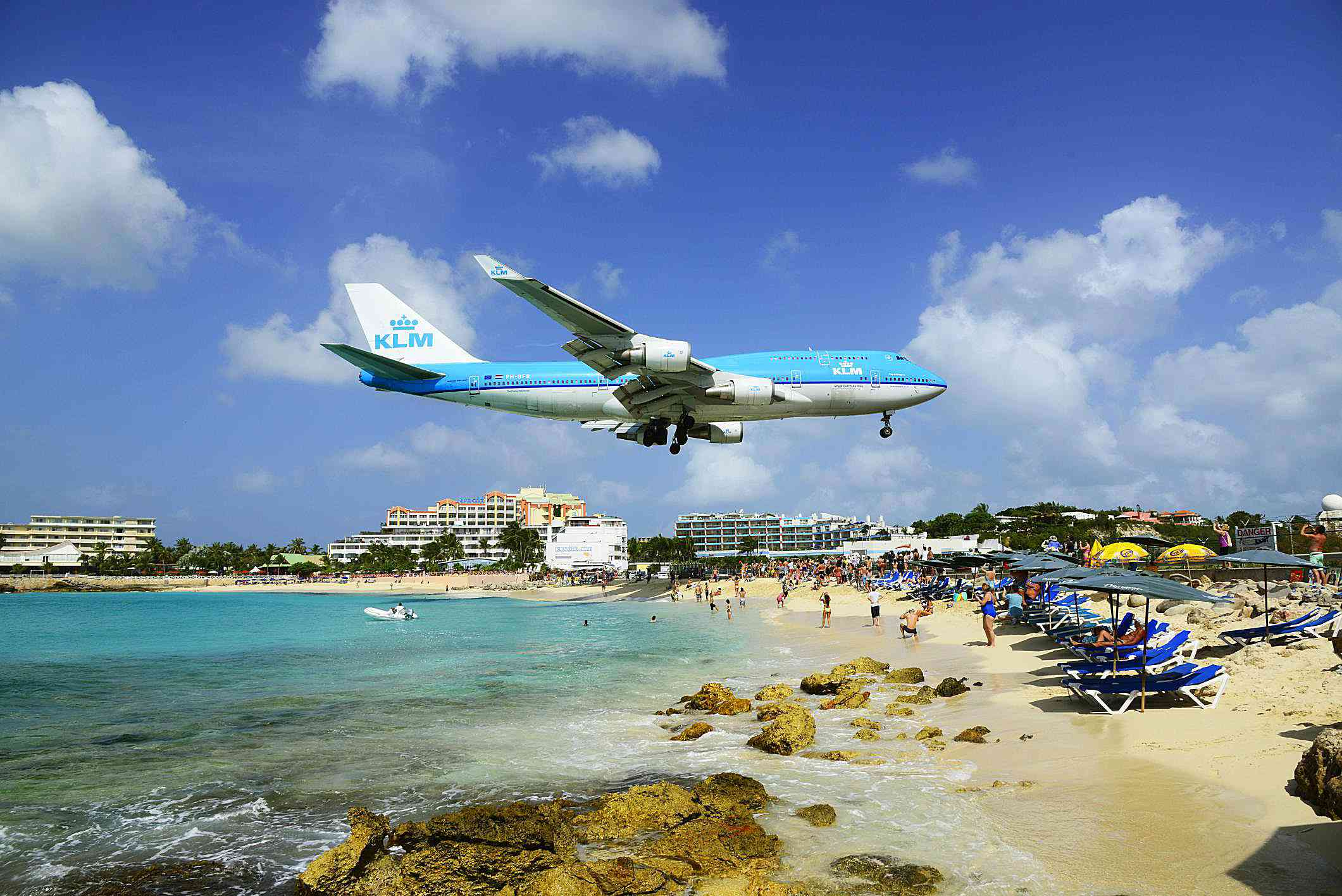 A KLM airplane landing over Maho beach.