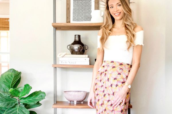 Alisha Agrellas Home Tour - Alisha standing in front of bookcase