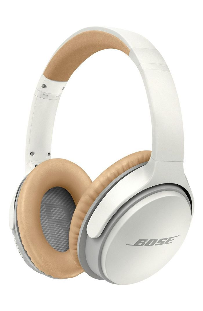 A pair of white Bose headphones with brown leather detailing.
