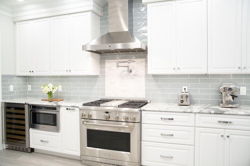 best kitchen ideas - all white kitchen cabinets with silver appliances