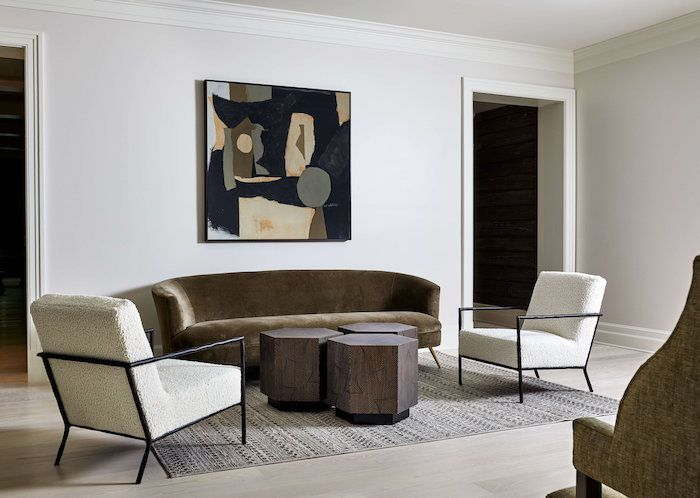 minimalist neutral living room with wooden geometric coffee tables